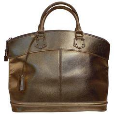 b2524c3b14db Louis Vuitton Suhali Gold Bag