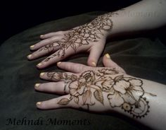 Two steampunked henna hands