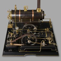 Steam Engine Toy by Märklin also Called Electrical Manufacture, circa 1890 | From a unique collection of antique and modern scientific instruments at https://www.1stdibs.com/furniture/more-furniture-collectibles/scientific-instruments/