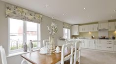 Interior Designed Kitchen / Dining room in a french style, using a grey, apple yellow, chalk white and cream colour scheme.  Taylor Wimpey 2015.