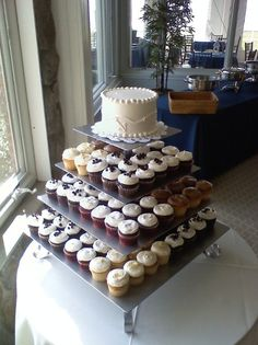 Want an outdoor wedding.  Cupcakes are easy. no cutting. yet still the traditional touch of the cake on top.  Needs more color though.