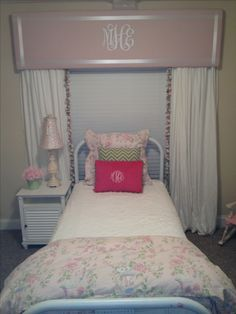 Monogrammed cornice board for girl's room.