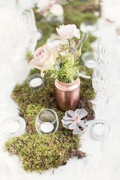 The mason jar is such a chic rustic touch to the centerpiece decor. Click to see more gorgeous details from this wedding. photo: Craig and Eva Sanders