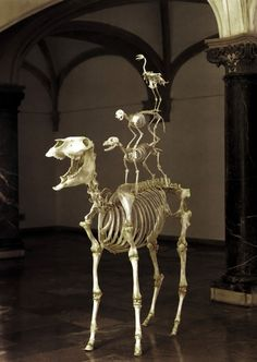 'Love lasts forever' Maurizio Cattelan, 1999. (Skeletons of a Donkey, Dog, Cat, and a Rooster, stacked atop one another in order of descending size.)