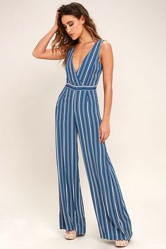 The Montauk Yacht Club Blue and White Striped Jumpsuit is our beach resort go-to! Lightweight woven fabric in classic stripes shapes a surplice bodice and banded waist with tying sash. Flowy, wide-leg pants complete the look.