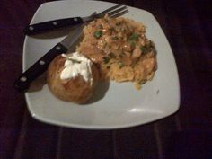 Spicy Chicken and rice..side dish baked patatoe with crème fraiche...