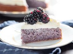 Blackberry Cake With Cream Cheese Frosting Recipe | This unusual cake gets its all-natural flavor and color from an infusion of fresh blackberry purée. Whether finished with fruity whipped cream or tangy cream cheese frosting, it makes an easy summer dessert or a slightly indulgent addition to brunch.