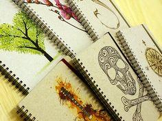 Notebooks by Ecopapelaria: hard cover, handmade paper, elastic closure, 80 recycled sheets and cool design. www.ecopapelaria.com
