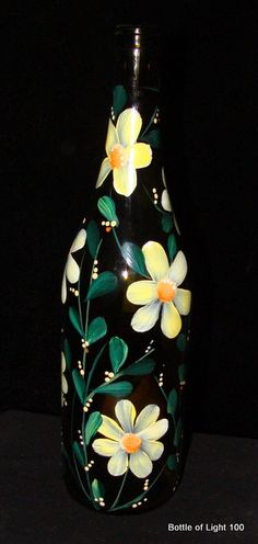 Recycled wine bottles, hand painted, with 20  tiny lights inside . Great gift, idea decoration by day, nightlight at dark.