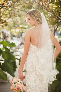 Lace wedding gowns look beautiful complimented by a lace edged veil. Anne Barge bride.