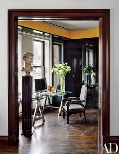 In a Nicholas Kilner–designed New York penthouse, an 18th-century bust overlooks the office's Ralph Lauren Home desk and 19th-century Russian armchair.