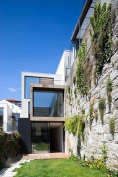 ATKA Arquitectos uses cork cladding to minimise noise inside Casa Bonjardim