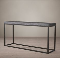 RH's Hopkins Console:We've reproduced the lines of mid-century modernism in the industrial materials of our contemporary table. A deep slab of steel-wrapped metal sits atop an iron base, offering a clean and eminently functional profile.