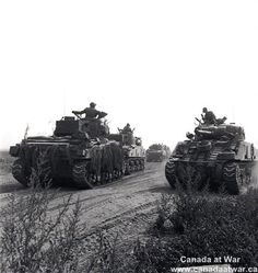 Canadians at Falaise - Canadian tanks move into position for attack toward Falaise, between Hubert-Folie and Tilly-la-Campagne, August 8th, 1944.