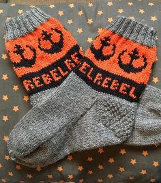 Free Knitting Pattern for Rebel Alliance Socks - Star Wars inspired socks with Rebel Alliance emblem and repeated REBEL letters. Designed by Marie Wall. SizesAdult & Teen