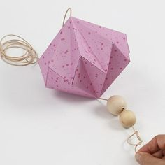 A hanging decoration from two large paper diamonds and in size respectively) on a long leather cord with wooden beads at each end. Each paper diamond is folded and glued from a piece of square Vivi Gade Design paper (the Helsinki series). Paper Diamond, Paper Cutting, Cut Paper, Arts And Crafts, Paper Crafts, Origami, Paper Folding, Christmas Diy, Creative
