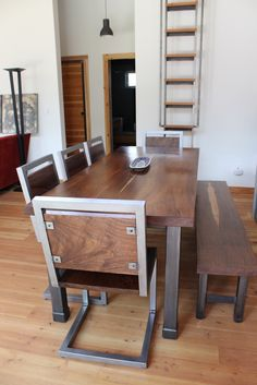 Handcrafted Black Walnut table and chairs. Industrial modern design.