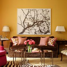 Here, the deep brown sofa and red chair bring out the vibrancy of the honey-colored walls: http://www.bhg.com/decorating/seasonal/spring/decorate-with-springs-hot-colors/?socsrc=bhgpin040914makeitrich&page=10