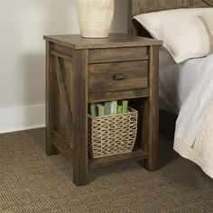 Complete your bedroom with the Altra Farmington Night Stand. Inspired by the farmhouse style, this rustic night stand resembles a wooden barn door and adds a unique touch to your space. Made in USA of U.S. and imported parts.