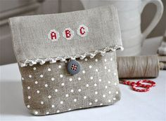 cross stitch & linen pouch with monogram Soooooooooo cute!