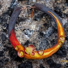 "Author necklace ""Lava flowers"": wool, copper, brass, hot enamel."