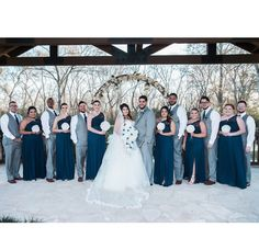 This gray + navy blue bridal party is so classy!  Love the long, navy blue bridesmaid dresses, gray vests + pants for the groomsmen, and the dominantly white bouquets.  Such a great bridal party look for a winter wedding! Photo taken at THE SPRINGS Event Venue.  Follow this pin to our website for more information, or to book your free tour! SPRINGS location:  Stonecreek Hall in Katy, TX Photographer:  Studio H-Town #bridalparty #winterwedding #weddingcolors #bridalpartyphotos