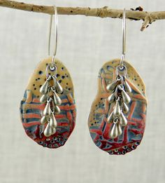 "Week 19/52 Earrings-- Polymer clay with a manipulated impression,  colored with oil paints. Purchased metal drops and silver ear wires.  For more on my process, visit my blog"" storiestheytell.blogspot.com"
