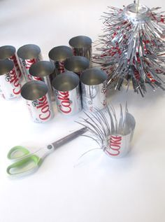 53 Stunning And Unique Recycled Christmas Tree Decoration Ideas. Today, people tend to forget recycling, one way of saving up and prevent bigger expenses. It's the people's human nature to just&nb. Recycled Christmas Tree, Types Of Christmas Trees, Metal Christmas Tree, Coke Can Crafts, Pop Can Art, Christmas Decorations Sale, Diy Pet, Aluminum Can Crafts, Tin Can Flowers