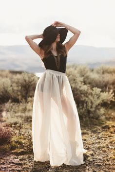 Gorgeous outfit, specifically the dark shorts and see through maxi skirt! Want! Photo by. Andria Lindquist