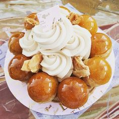 "I think this pastry looks like a UFO :3 Much better than the strawberry tart, the Saint Honore~ ""Puff pastry and vanilla caramel cream topped with cream puffs dipped in caramelized sugar"" says a website #sainthonore Yum but this just made me miss the one at Laduree ><"