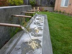 Tamate landscape was hired to give this yard a makeover in the hills of South San Francisco. The focal point of this project will be a water feature with a series of 1-1/2″ copper pipes spilling water into a basin. All components of the water feature are custom.