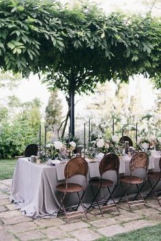 Italian villa destination wedding, reception tables under a lush garden arbor