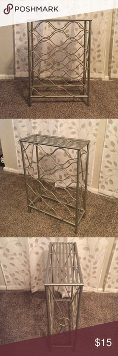 """Wine Rack Holds 11 bottles. Measures 15""""x6""""x21.5"""". Brushed nickel color. Small scuffs on corner pictured otherwise perfect condition. Other"""