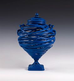 From 1986 to 2006 Michael Eden has worked as a craftsman specialized in the design and manufacturing of vases in ceramics and semi-liquid clay. Description from lanciatrendvisions.com. I searched for this on bing.com/images