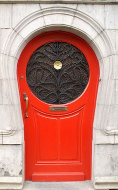 Red door with floral grille