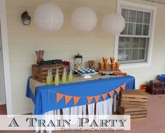 "My son is completely into trains.  He chugs through stores, weaves imaginative tales while playing and has drawn the whole family into ""train fever.""  So for his 5th birthday friends' party, we didn't have to think too hard for a fun theme.  The best part?  Dear friends of ours have a 1/8 scale railroad on …"