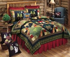 Timberline Quilt shows a moonlit forest in its patchwork design. Blocks featuring a cabin, trees, and wildlife against a navy background are joined by more trees in colored blocks and by patchwork prints. Rustic Quilts, Rustic Bedding, Twin Quilt, Quilt Bedding, Colchas Country, Moose Quilt, Colchas Quilting, Wildlife Quilts, Timberline Lodge