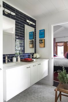 A double-sink vanity gives you plenty of hidden bathroom storage. The navy tiled wall is fun and unexpected. >> http://www.hgtv.com/design/hgtv-urban-oasis/2015/master-bathroom-pictures-from-hgtv-urban-oasis-2015-pictures?soc=pinterest