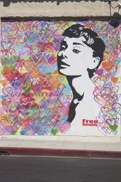 """If These Walls Could Talk: A Guide to L.A.'s Neatest Street Art #refinery29  http://www.refinery29.com/la-street-art#slide6  What: This colorful piece, also by Free Humanity, features another style icon: Audrey Hepburn. The quotes reads: """"The best thing we hold onto in life is each other.""""  Where: Sunset Boulevard (at Seward Street)."""