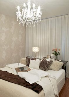 I like the idea of wall to wall curtains behind the bed #bedroom and the table for headboard!