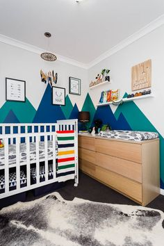 Baby boy's nursery with bright colours mountains painted as a background. The feathers and other forrest related products complement the overall theme. I love that the room is different from your standard boy's room. Baby Boy Rooms, Baby Boy Nurseries, Rock A Bye Baby, Interior Design Services, Paint Colors, Toddler Bed, Nursery, Move Mountains, Bright Colours