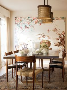 The custom dining table is from BDDW; chairs are from Midcentury L.A.; the painting is by Elisa Johns.