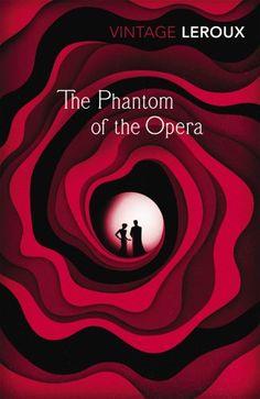The Phantom of the Opera (Vintage Classics) by Gaston Leroux http://www.amazon.co.uk/dp/0099560550/ref=cm_sw_r_pi_dp_0TZGwb1MYEVJP