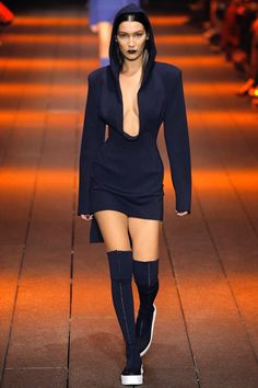 DKNY Spring 2017: Bella Hadid walks the runway in classic navy tech milano hooded jacket dress