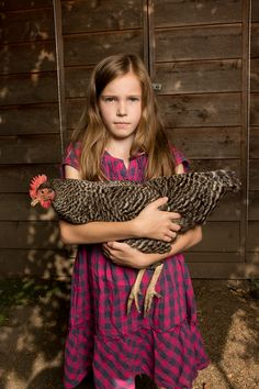 Girl and her chicken