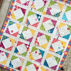 Second Grade Quilt by April Rosenthal from the book Precut Primer by Barb and Mary of Me and My Sister Designs using Meadowbloom fabric for Moda. www.aprilrosenthal.com