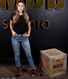 Utilitarian look: Her deceptively simple ensemble of T-shirt, jeans and boots was the perfect fit for the wooden box theme