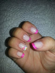 hello kitty nails - so cute! I am wondering if my nail gal can do this kind of art with a shellac manicure.  I also might want a bow on the hello kitty finger.