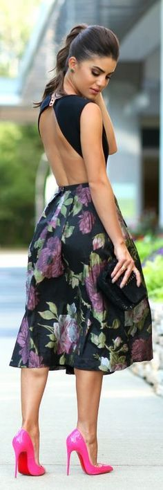 Gorgeous back detail and floral flare skirt. Pumps not quite right for the look though.