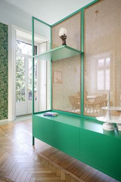 custom cane storage and room divider in lush green - milan apartment | coco kelley